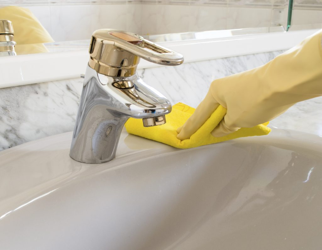 Cleaning common guest touch points in a bathroom