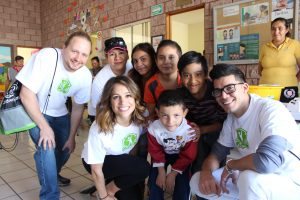 Trip attendees with a group of children
