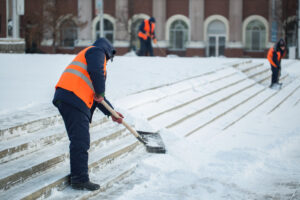 Workers shoveling snow