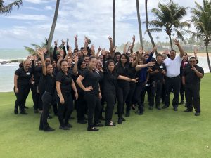 The Service Companies employees on a beach