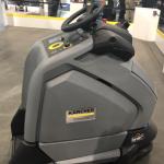 Ride-on electric floor vacuum