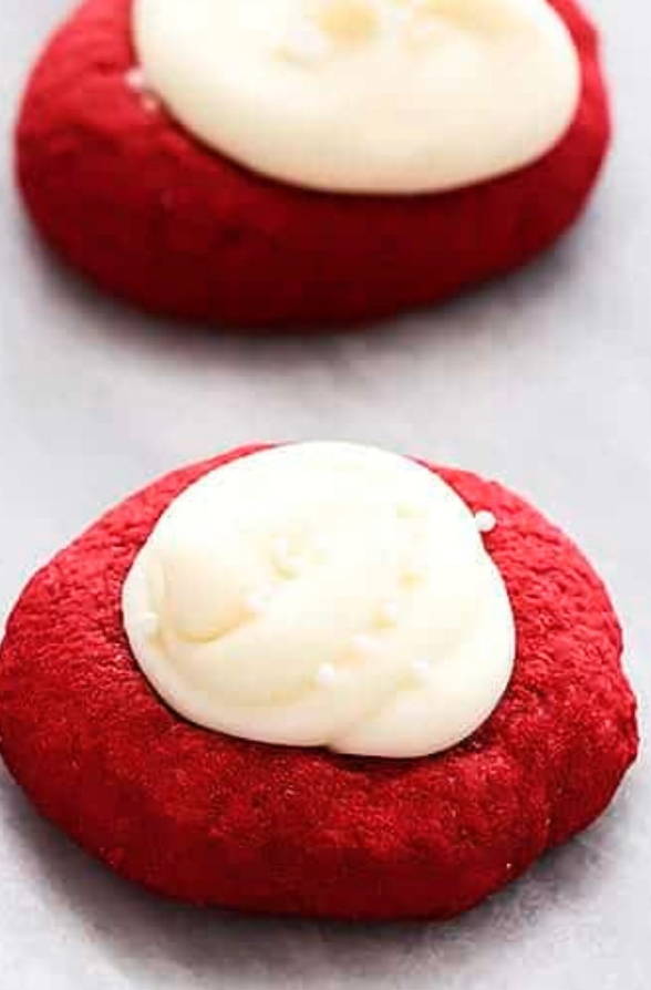 Two red velvet thumbprint cookies