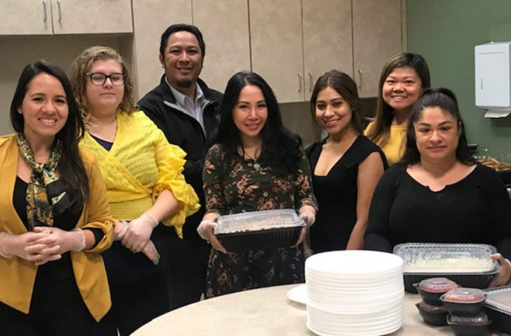 group of coworkers helping with a thanksgiving meal
