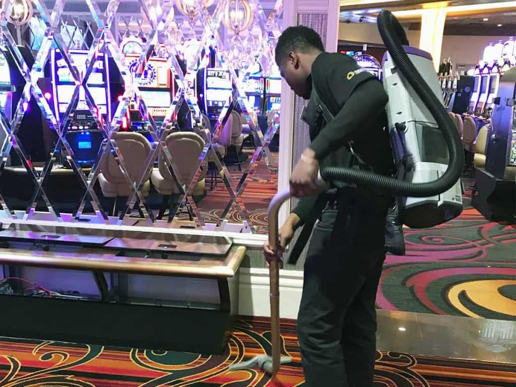 EVS attendant vacuuming a casino