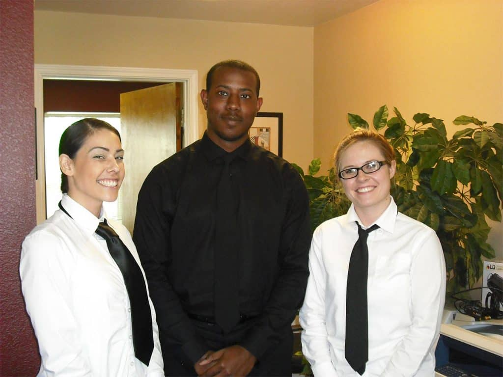 three food servers in uniform