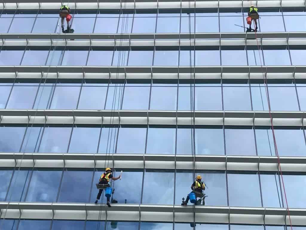 window cleaners cleaning a glass building